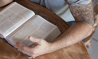 Ex-convict reading Bible